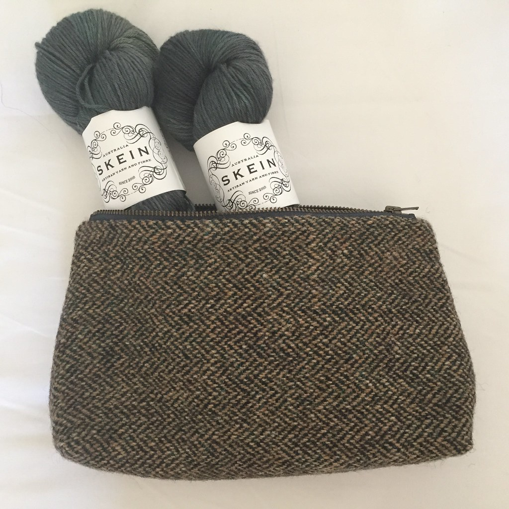 harris tweed pouch full of skein merino silk sport in gingko