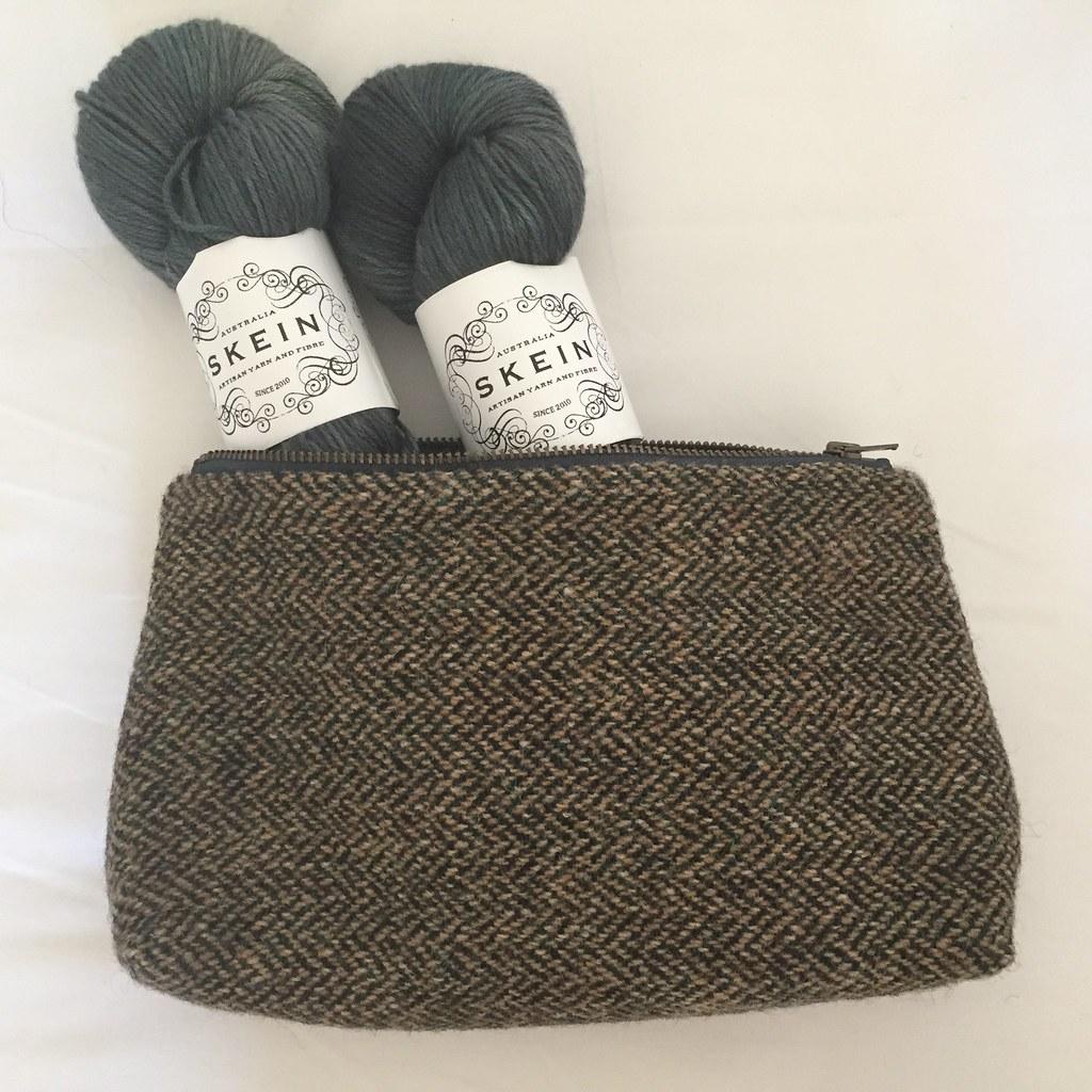 harris tweed pouch full of skein merino silk sport in gingko