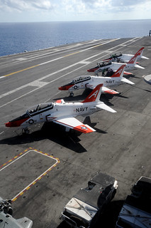 T-45 C Goshawk training aircraft are being prepped for flight operations | by Official U.S. Navy Imagery
