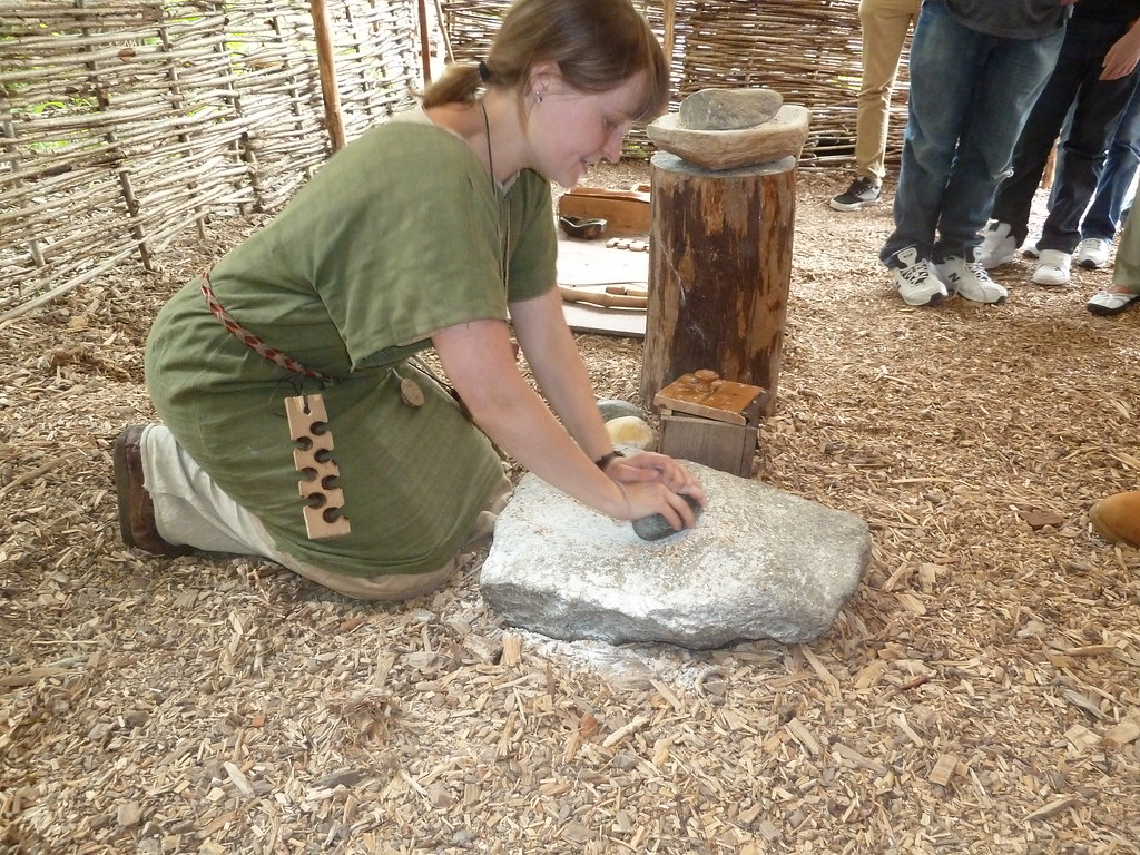 Experimental archaeology: grinding corn at Crannog Centre.
