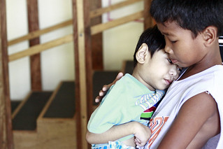 Older brothers carries younger sibling | by World Bank Photo Collection