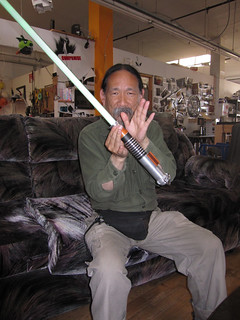 Mike Kan with the meeting lightsaber | by Liz Henry