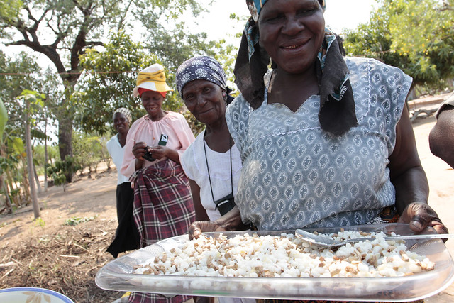 Anna Nyathi shares dish of corn and marula kernels in Belfast Mpumalanga Province South Africa.