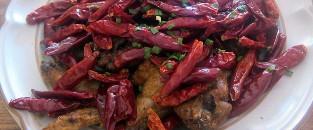 chicken wings with explosive chili peppers at mission chinese | Flickr ...