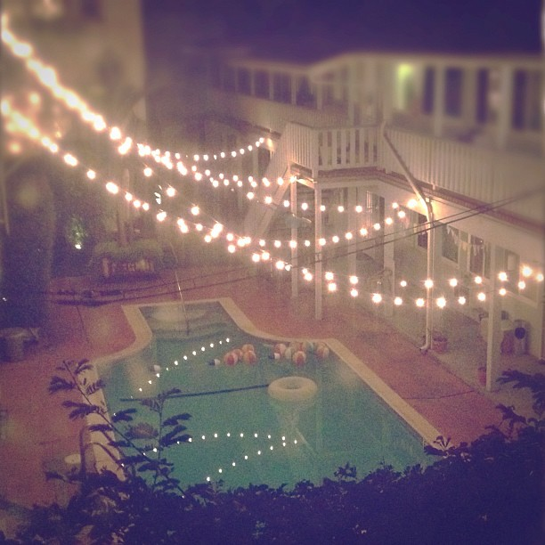 String lights over the pool - a magic urban yard. This com? Flickr