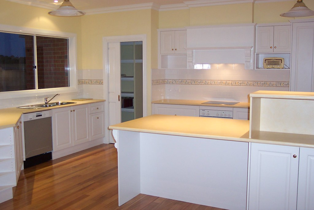 Kitchens With Yellow Walls And White Cabinets