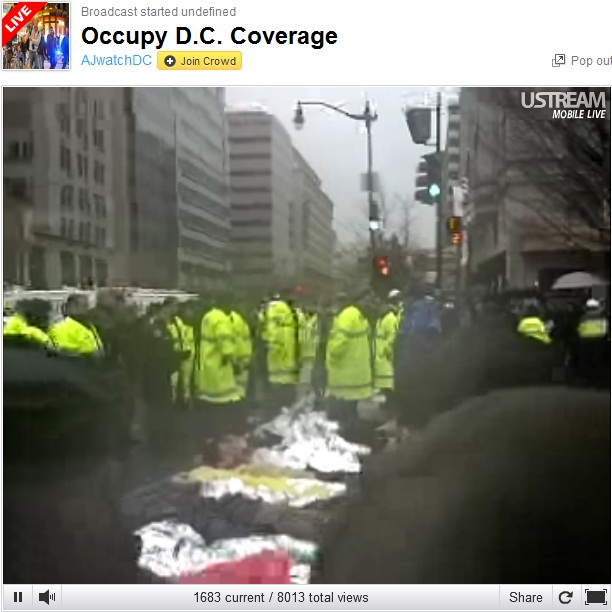 Occupy K Street DC Protesters lay down blocking street