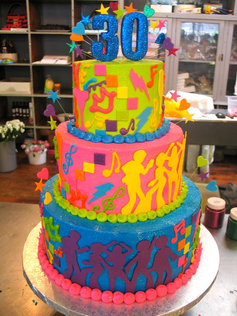 3 Tier Wicked Chocolate Cake Iced In Blue Pink Amp Green