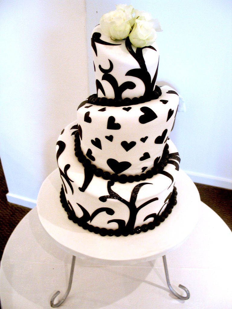 3-tier Mad Hatter wedding cake covered in white fondant de… | Flickr