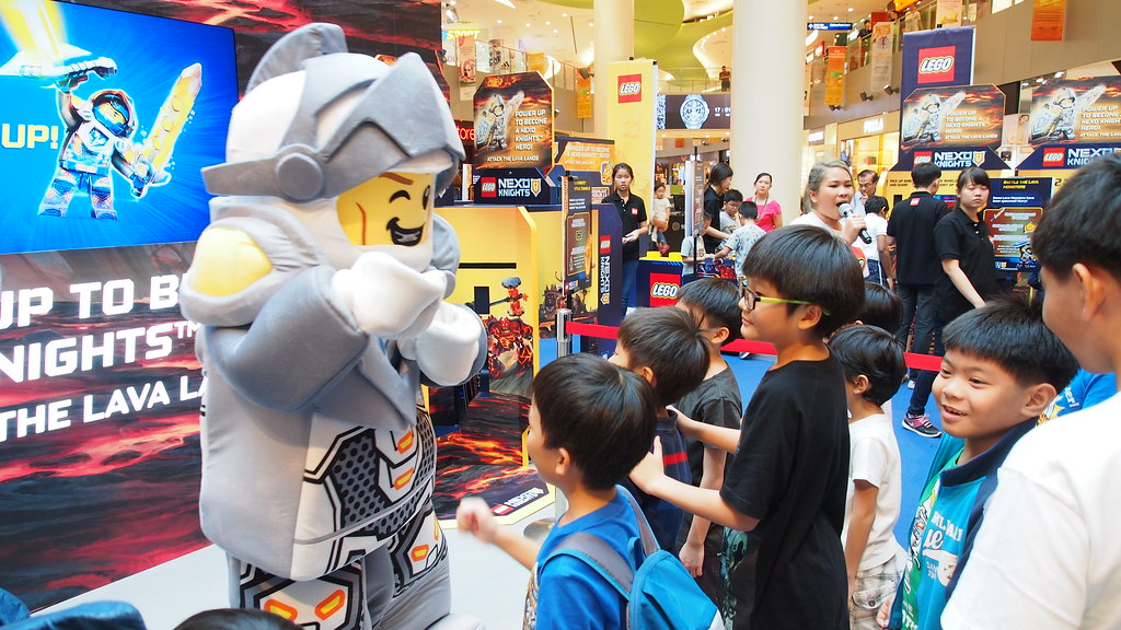 Excited NEXO Knights fans queueing up to bump fists with Lance.