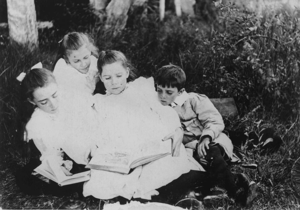 Group Of Children Sitting On The Grass Reading Books, 1900 -3372