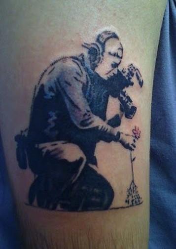 Banksy cameraman tattoo 2010 graffiti mural collin for Back mural tattoos
