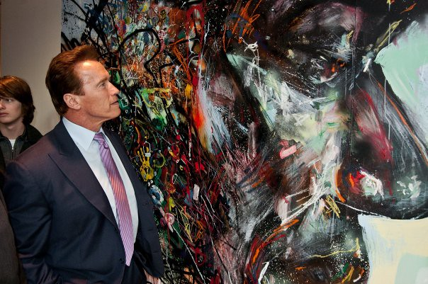Arnold Schwarzenegger looking at Hussein by David Choe | Flickr Arnold Schwarzenegger