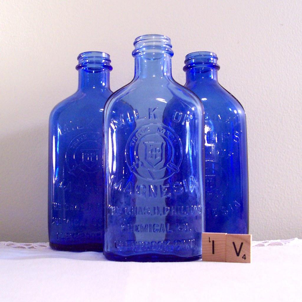 Cobalt blue glass bottle collection milk of magnesia flickr - Cobalt blue bathroom accessories ...