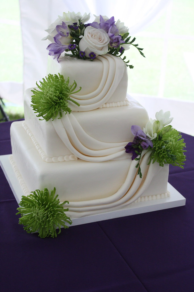 green and purple wedding cakes purple and green fondant swag wedding cake jen flickr 14959