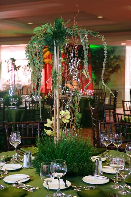 Jungle centerpiece with trees vines and grass for a rainfo ...