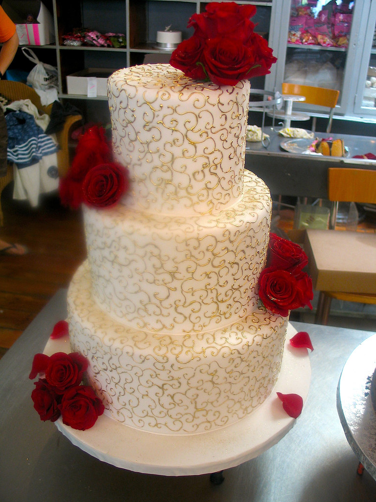 3 Tier Cream Wedding Cake Decorated With Delicate Gold Twi