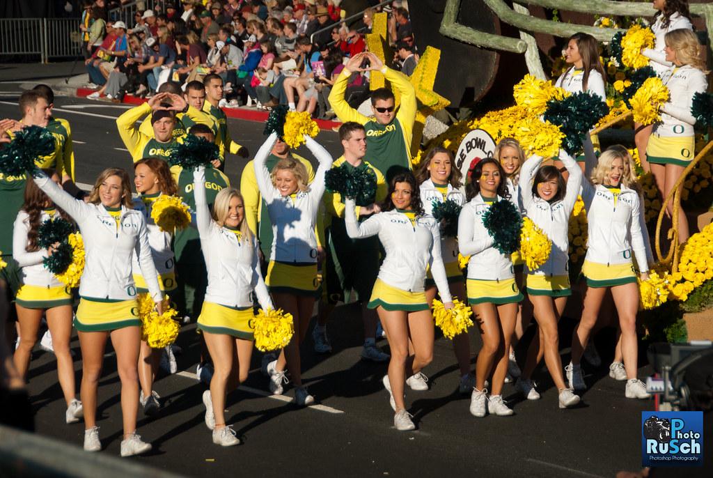 University of Oregon Cheerleaders walking aside Float | Flickr