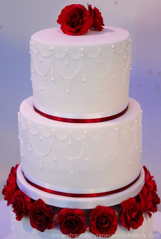 3 tier wedding cake with roses roses and piped detail 3 tier wedding cake this 10350
