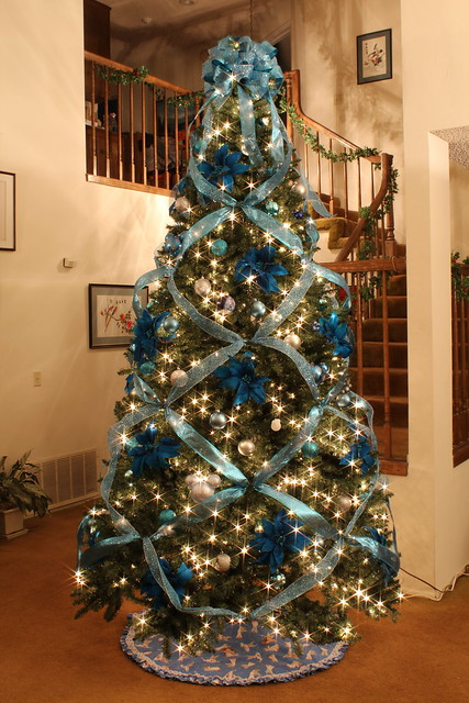 Blue and silver elegant christmas tree with a little dis