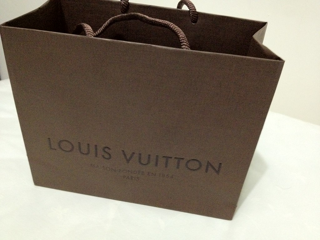 White Shopping Bag With Red Letters Ending In S
