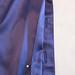 Blue silk blouse buttonholes