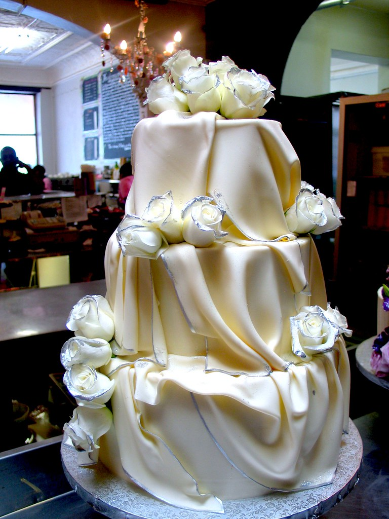 3 tier white chocolate wedding cake recipe 3 tier chocolate wedding cake iced in white chocola 10354