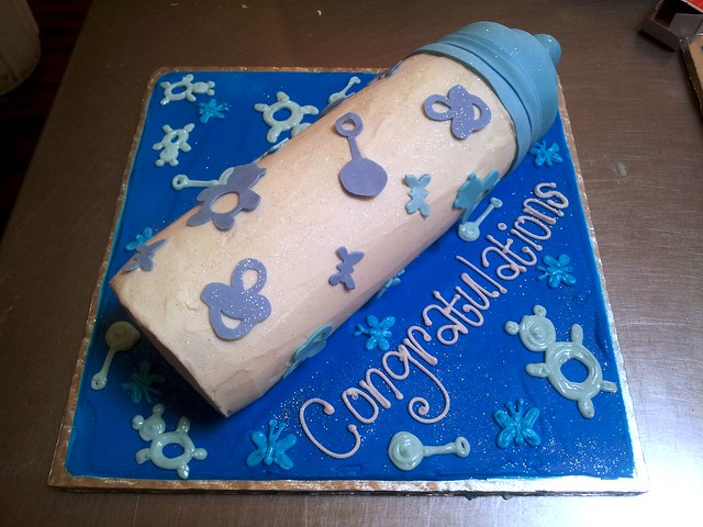Baby Shaped Cake Images : 3D Baby Bottle shaped cake iced in butter icing decorated ...
