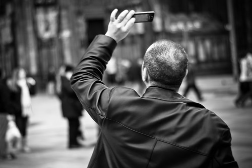 Man filming with smartphone