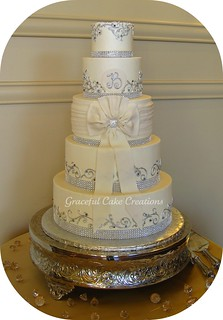 Elegant Ivory Buttercream Wedding Cake with Bling Ribbon, Jewels and Bow | by Graceful Cake Creations
