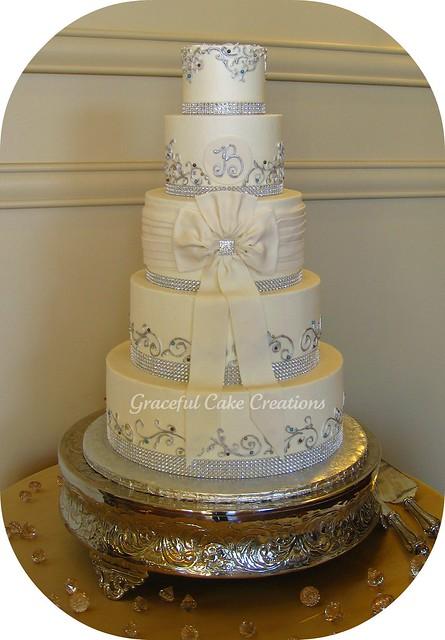 Elegant Ivory Buttercream Wedding Cake with Bling Ribbon ...