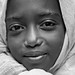 portrait in blackwhite of a child with big intense eyes in the monastery lake tana, ethiopia