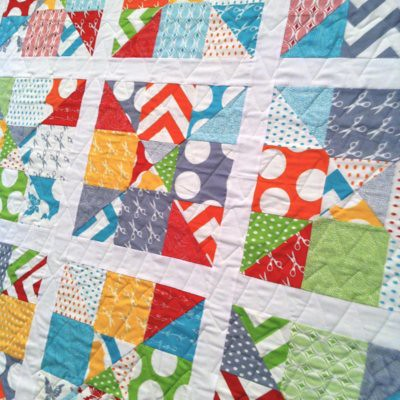 Half moon modern charm pack quilt made with 2 charm packs