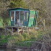 The curious little hut on the opposite bank from us