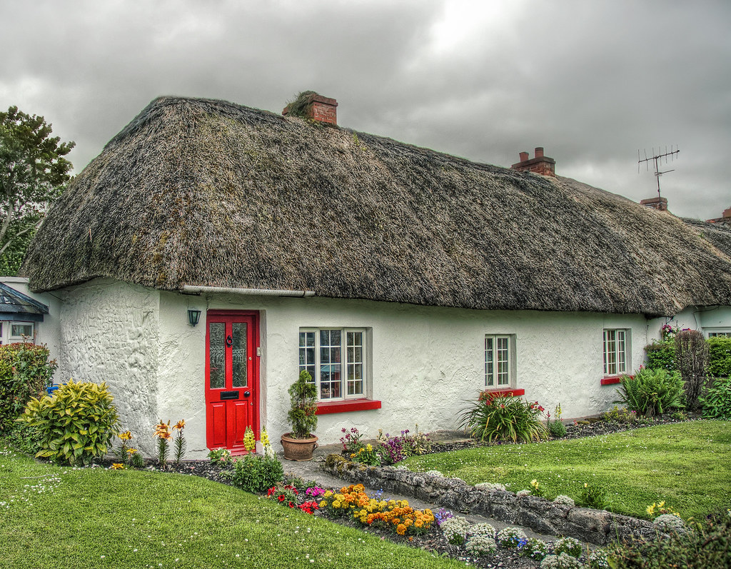 The Thatched Roof House With The Red Door This Photo Was