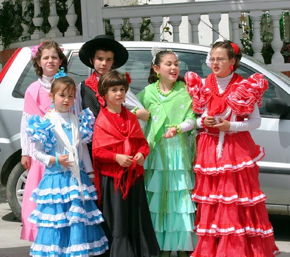 spanish children in traditional clothing at village festiv. Black Bedroom Furniture Sets. Home Design Ideas