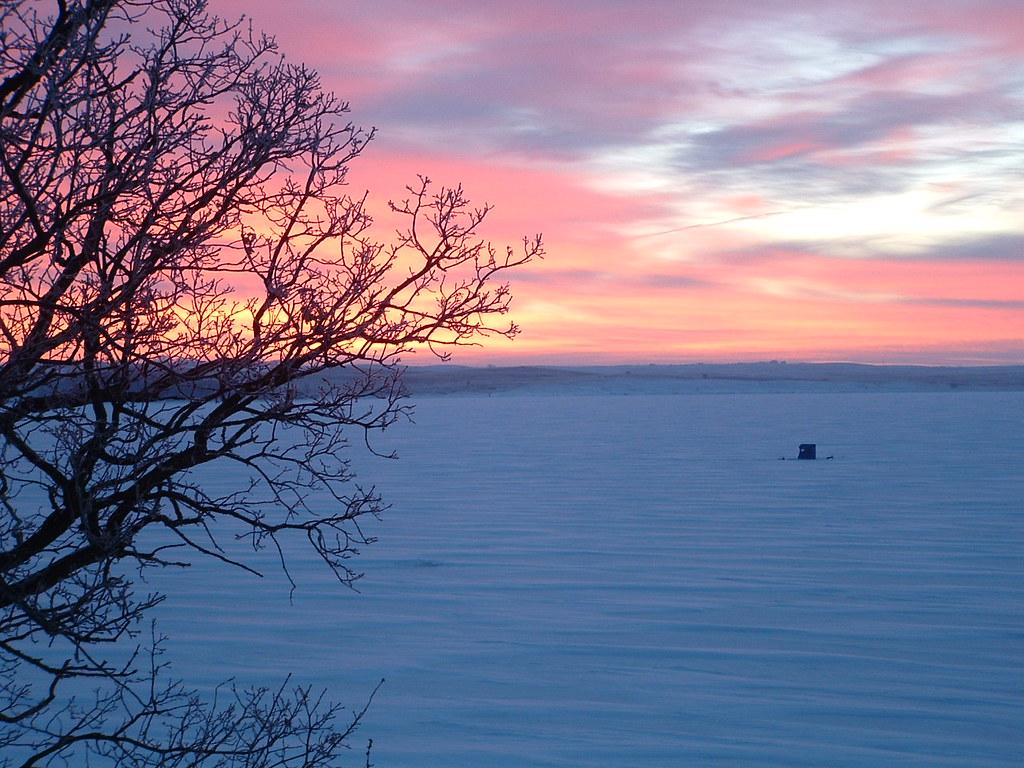 Ice fisherman at sunrise waubay national wildlife refuge for Waubay fishing report