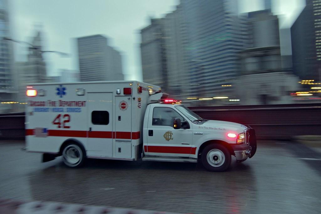 Rushing To The Scene An Ambulance Rushing Down State