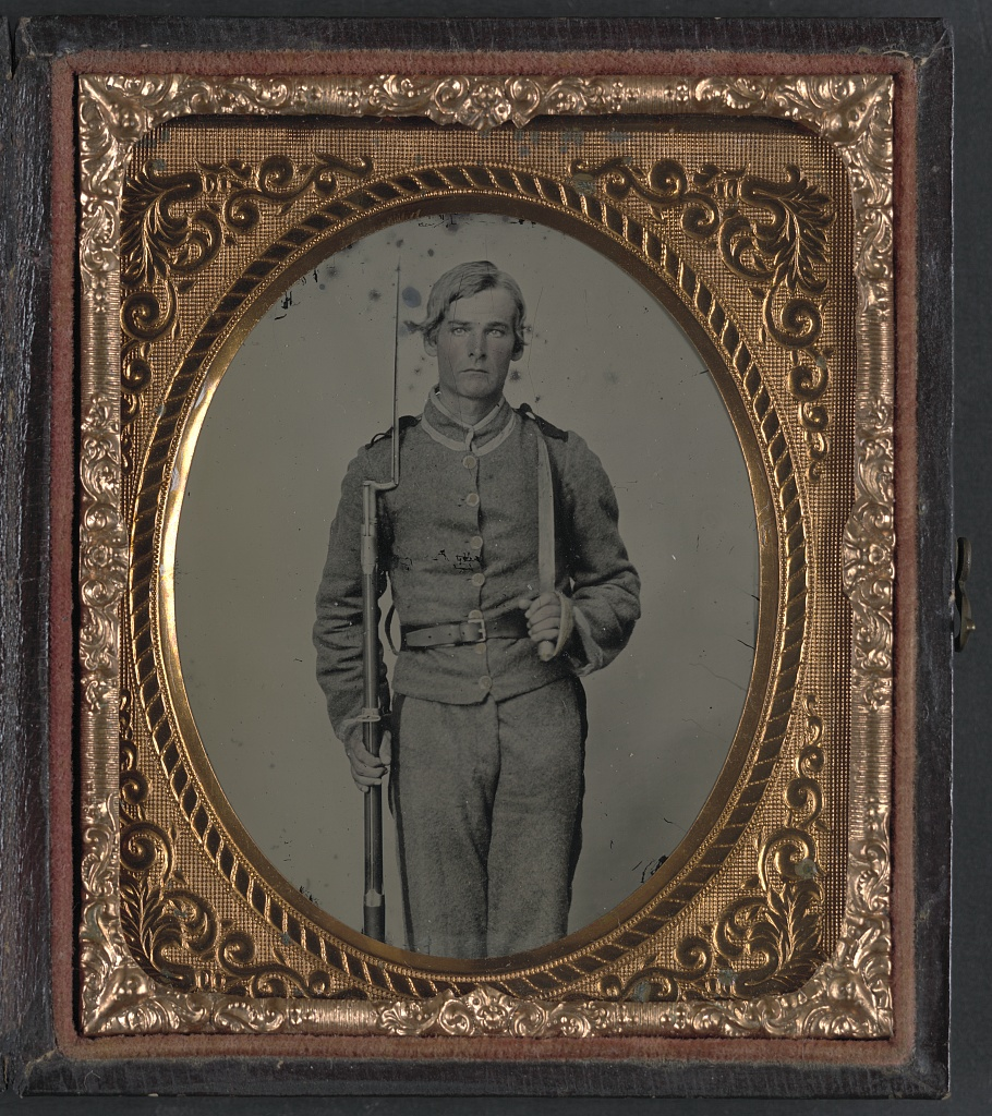 Unidentified Soldier In Confederate Uniform With Musket A