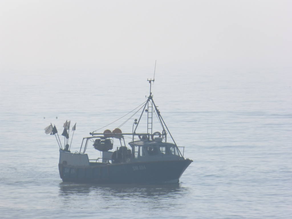 Dead calm fishing boats around saltdean beach les for Chatfield fishing report