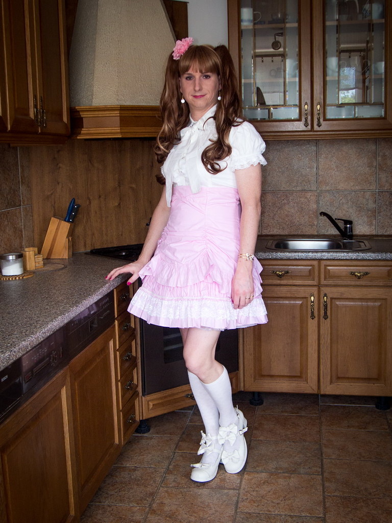 Russian mistress baby doll in pink stockings and skirt demeans the younger boy using it as a chair wwwlifecamgirlscom - 4 5