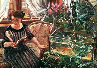 Lovis Corinth - Woman Reading near a Goldfish Tank | by ondiraiduveau