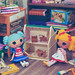 Lalaloopsy playing with dollhouse