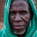 portrait of a man in front of great mud mosque in the bani,in the tribal region of the Sahel, northern Burkina Faso