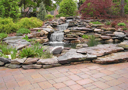 Natural stacked stone koi pond with brick surrounding flickr for Stone koi pond