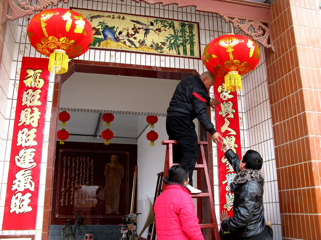 Putting up door decorations caitriana nicholson for Chinese home decorations