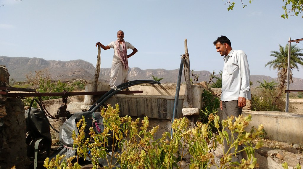 Kunj Bihari (right) with a farmer on his well.