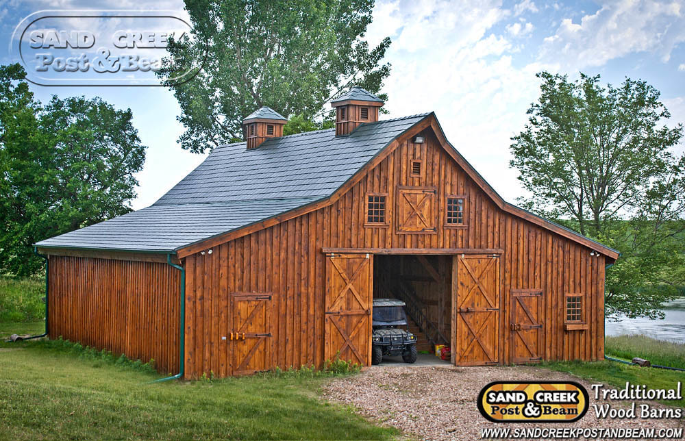 Ponderosa sand creek post beam traditional wood barn for Wood barn homes