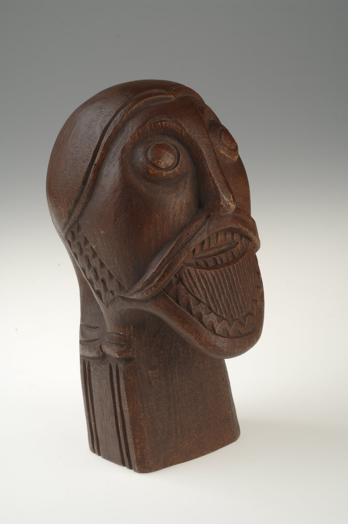 Wood carving of a man s head copy