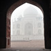 Foggy Taj Mahal through the doorwar